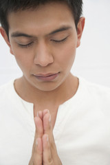 Praying Hispanic man