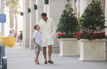 Caucasian father and son walking together