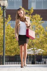 Caucasian woman carrying shopping bag