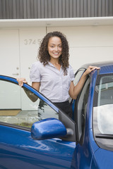 Mixed race woman getting into car
