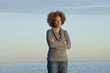 Black woman standing near ocean