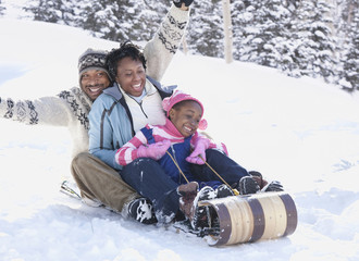 African American family sledding