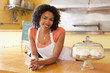 African American business owner leaning on cafe counter