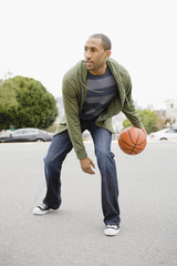 African American man playing basketball