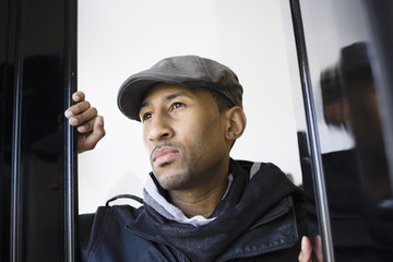 African American man wearing cap in doorway