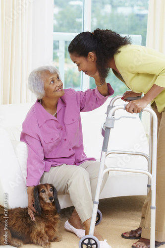African American woman helping senior mother