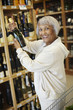 Senior African American woman buying champagne