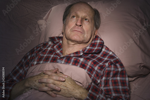Senior Caucasian man having trouble sleeping