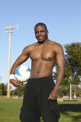 Black man holding soccer ball