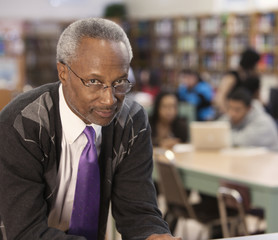 Black librarian in school library