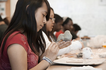 Students working with clay in classroom