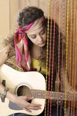 Hispanic girl playing guitar