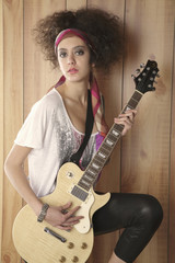 Hispanic girl playing electric guitar