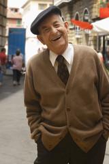 """""""Senior Hispanic man in cap, smiling"""""""