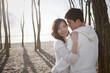 Korean couple hugging outdoors