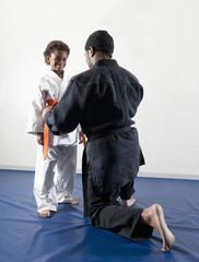African American boy practicing karate with sensei