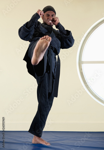 African American man practicing karate