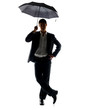 Handsome young business man standing under umbrella