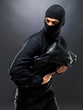 Bandit bag : Portrait of a young male burglar running with a handbag...