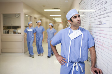 Asian surgeons looking at hospital schedule