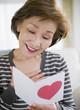 Japanese woman reading valentine card