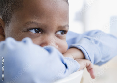 African American boy daydreaming