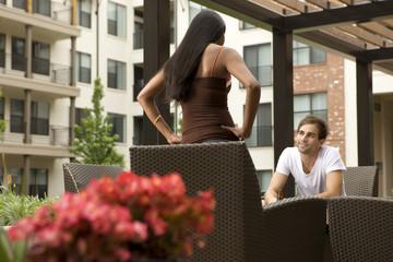 Couple talking on patio