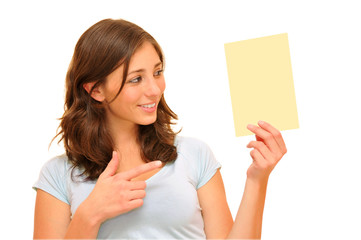 Beautiful young woman holding a blank card.