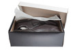 open shoebox with men's dress shoes