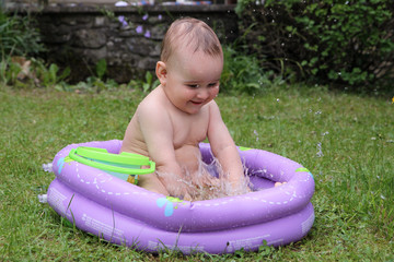 joy child in swimming-pool
