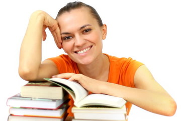 Yong smiling student with books