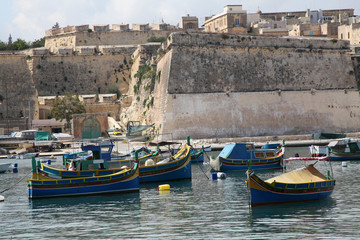 Luzzu boats in Kalkara creek
