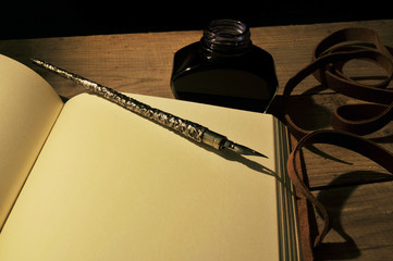 metal feather and notebook