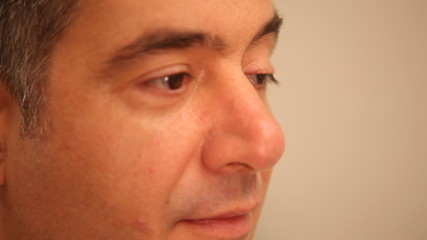 Mans face with eyes moving, close-up