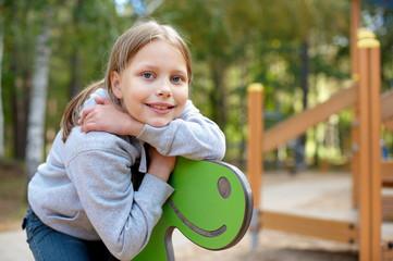 Outdoor portrait of smiling little girl