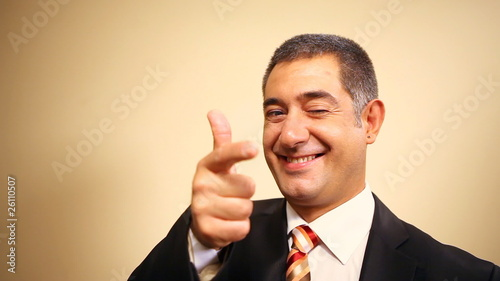 Businessman giving thumbs up, gun and surrendering