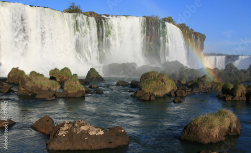 Igaucu falls with rainbow and rocks