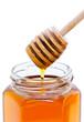 Cuillère à miel et pot de miel