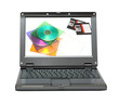 small laptop with discs and diskettes