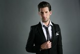 Fototapety Fashion young businessman black suit casual tie