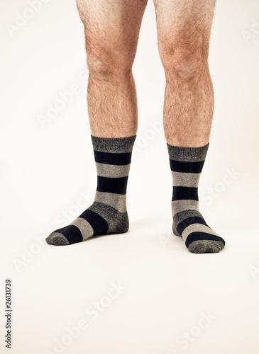 Bare man legs with socks