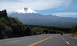 Highway down to an Andean valley. Cotopaxi in the background