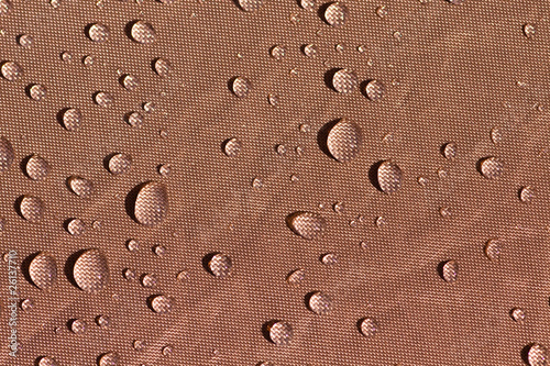 Drops on brown fabric