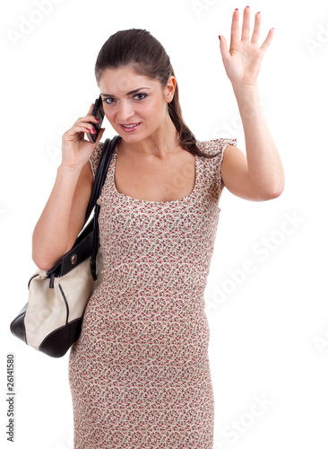 waving hello young woman speaks by a mobile phone