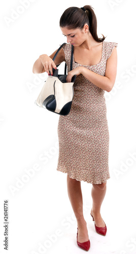 young, frightened woman in dress looking to bag