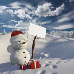 Pupazzo di neve con cartello