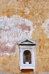 Niche in a weathered wall