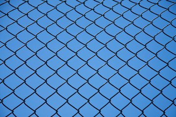 a separation fence against a blue sky