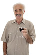 Senior holding glass of red wine