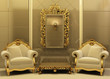 Luxury armchairs with  frame in old style interior